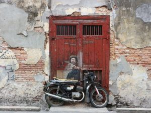 Mural of boy with helmet at George Town Penang