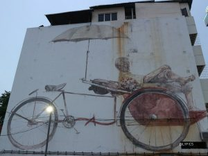 The Trishaw and the Paddler at George Town Penang